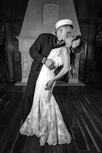 military groom and bride dancing and posing inside Chateau De Vie