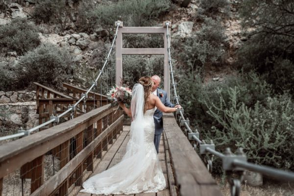 couple kissing on the bridge at wedding