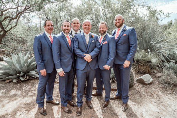 groomsmen smiling at wedding