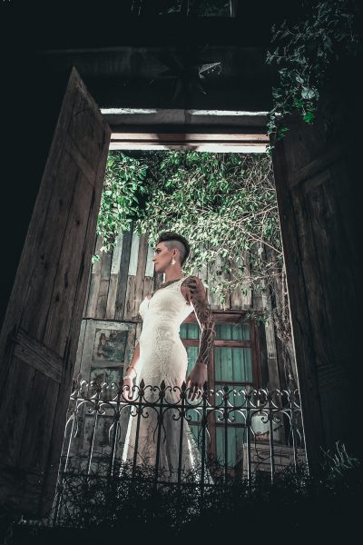 BRIDE MODELING THROUGH A DOORWAY